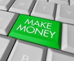 """""""Make Money"""" words written on a green colored button on keyboard"""