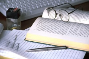 Book, pen, keyboard and glasses