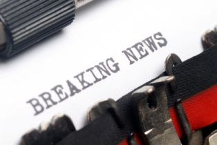 """Breaking News"" words typed on a paper"