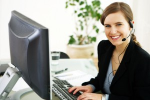 A nice Girl in front of a laptop screen working as virtual assistant