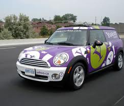 "A car filled with ""Yahoo"" advertising"