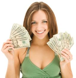 A beautiful girl showing dollar banknotes in her hands