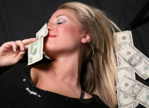 a beautiful girl lying in the midst of a lot of money