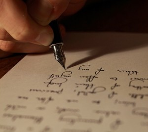 An hand writing on a paper