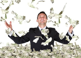 A man stands in the middle of a pile of dollars