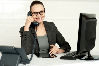 Businesswoman In Glasses Communicating On Phone