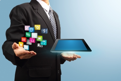 Tablet With Application Icons In The Hands Of Businessmen