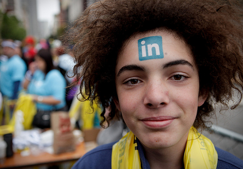 A Linkedin temporary tattoo decorates the forehead of Baptiste Vauthey at the 2010 Bay to Breakers race in San Francisco. Vauthey's father works for the company.
