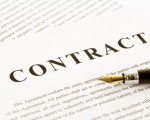"""CONTRACT"" word written on a paper with a pen"