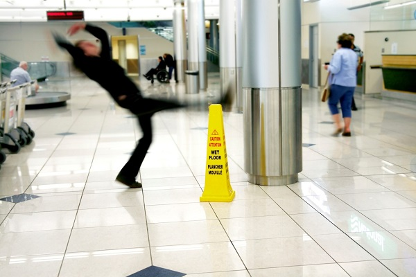 man slipping on a wet floor