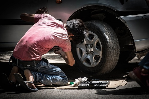 man changing a car wheel